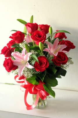 red roses with lilies