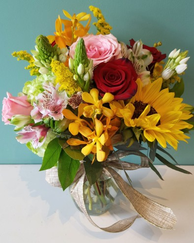 Sweet blossoms hawaii medium spring mix arrangement sunflower roses hydrangea star of bentham mokara orchid and alstroemeria colors and flowers in actual arrangement may mightylinksfo